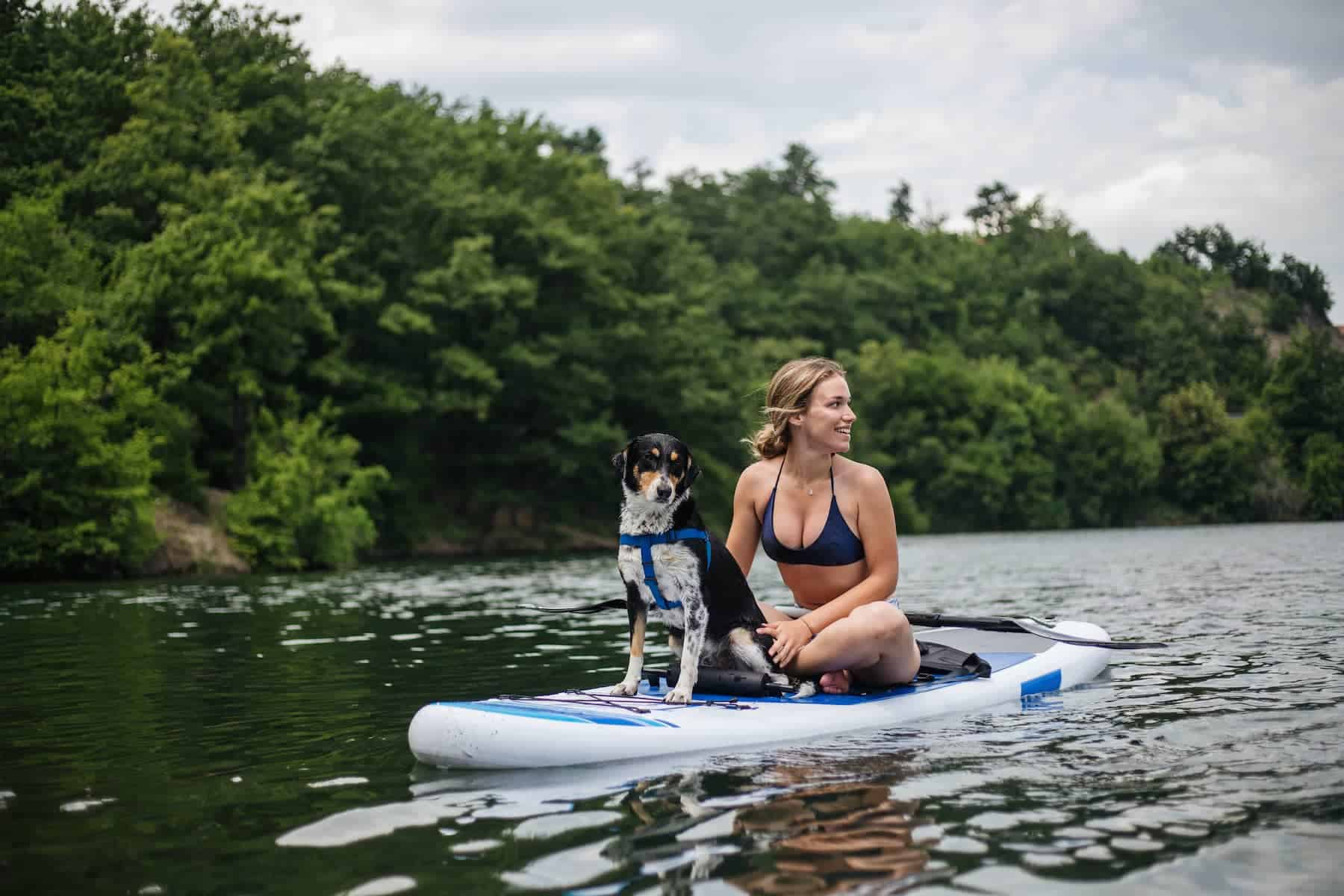 Slider_Woman and dog on paddle board_1800x1200C
